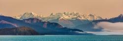 Alaska inside passage cruise landscape panorama of nature background. Alaskan mountain range in Glacier Bay, Alaska, USA.