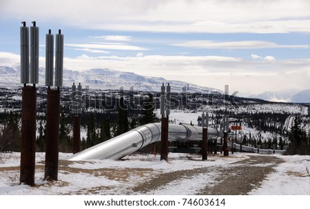 Alaska Oil Pipeline entering Isabel Pass in the Alaska Range - stock photo