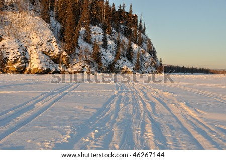 Alaska Ridge over Frozen River at sunset