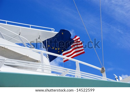 Alaskan and American flags waving from cruise ship,		Juneau,	Alaska