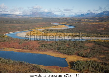 Alaskan river flowing through a mountain valley.