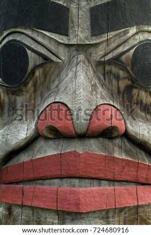 Alaskan Totem Pole Closeup. A detail view of an Alaskan Totem pole in southeast Alaska. #724680916