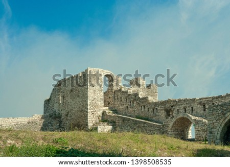 Albania - Berat - The strong upper corner tower of ancient Berat castle (aka citadel or fortress) with walls, arches and stairways (built 13 century). Space for text #1398508535