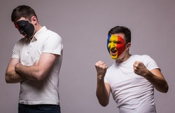 Albania vs Romania on grey background. Football fans of national teams demonstrate emotions: Albania â?? lose, Romania â?? win. European 2016 football fans concept.