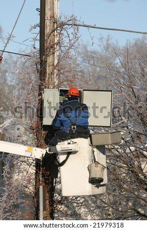 Albany - December 13: Lineman for the Utility Companies Make Repairs to Downed Power and Telephone Lines in After An Ice Storm on December 13, 2008 in Albany, NY