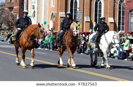 ALBANY, NY - MARCH 17: Albany New York Police department mounted unit in the 2012 St. Patrick's Day Parade on March 17, 2012 in Albany, New York.