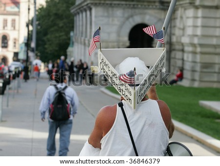 ALBANY, NY- SEPT 10: A Protester wears signs against President Obama's policies during a stop of the Tea Party Express tour on Septemmber 10, 2009 in Albany NY