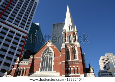 Albert Street Uniting Church surrounded by skyscrapers in Brisbane, Queensland, Australia.