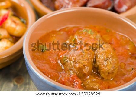 Albondigas a la jardinera (Meatballs in tomato sauce). Traditional Spanish tapas dish.
