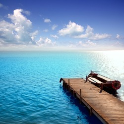 Albufera blue boats lake in El Saler Valencia Spain [Photo Illustration]