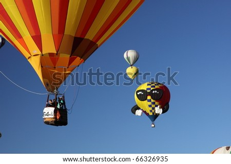 ALBUQUERQUE, NEW MEXICO - OCTOBER 9: Balloons fly over Albuquerque on October 9, 2010 in Albuquerque, New Mexico. Albuquerque balloon fiesta is the biggest balloon event in the the world. - stock photo