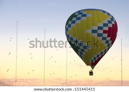 ALBUQUERQUE, NM - OCTOBER 10: A group of hot air balloons soar at Albuquerque International Hot Air Balloon Fiesta October 10, 2012 in Albuquerque, NM.
