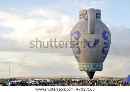 ALBUQUERQUE,  NM - OCTOBER 8: A vase shape hot air balloon soars at Albuquerque International Hot Air Balloon Fiesta October 8, 2009 in Albuquerque, NM.