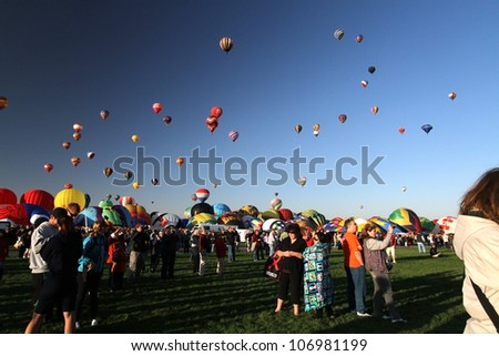 ALBUQUERQUE, NM - OCTOBER 1, 2011: Balloons float in the sky at the International Balloon Fiesta in Albuquerque, NM on October 1, 2011.  This is the world's largest hot air balloon festival.