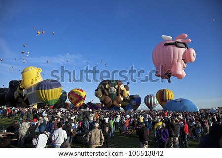 ALBUQUERQUE, NM - OCTOBER 02: Hot Air Baloon Fiesta in Albuquerque, New Mexico. Crowd of the visitors observing the ascending balloons on October 2, 2011.