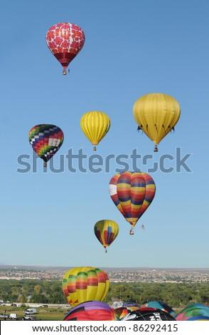 ALBUQUERQUE, NM - OCTOBER 8: Mass hot air balloon ascend during the annual International Balloon Fiesta in Albuquerque, NM on October 8, 2011