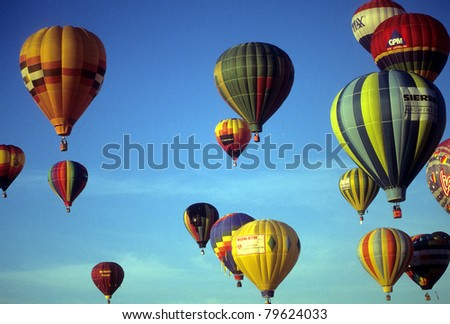 ALBUQUERQUE - OCT 8 -  Tourists ride hot air ballons during a mass ascension at the International Balloon Festival,  on Oct 8, 1992 in Albuquerque, New Mexico