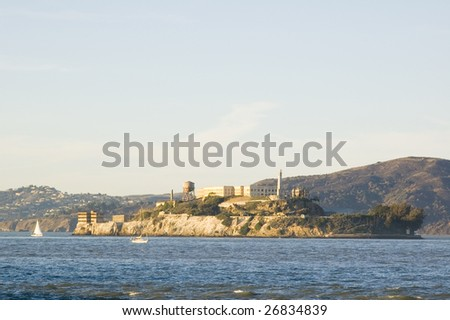 Alcatraz island at sunset, with sail boats in the bay