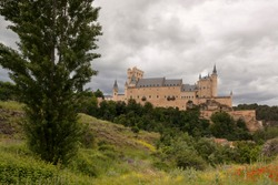 Alcazar de Segovia next to the Templar church of Vera Cruz. Spring scene Castilla y Leon, Spain. Europe