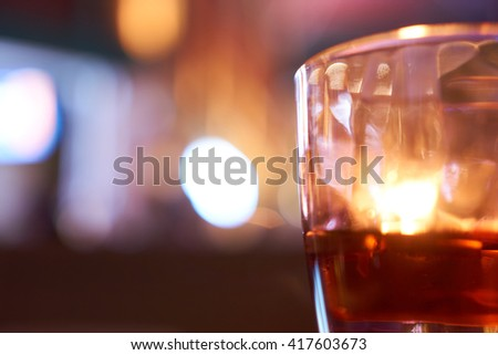 alchohol glasses with a background of neon lights and bokeh #417603673