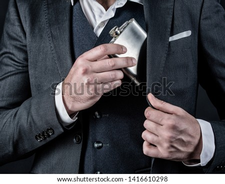 alcohol abuse of man has bad addiction. bachelor and single. businessman in suit. concept of alcohol abuse. male with beard put flask in pocket. male drink alcohol. alcohol abuse. hangover.