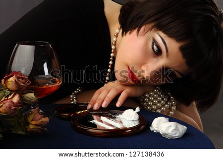 alcohol and cocaine abuse: vintage styled portrait of a young beautiful woman
