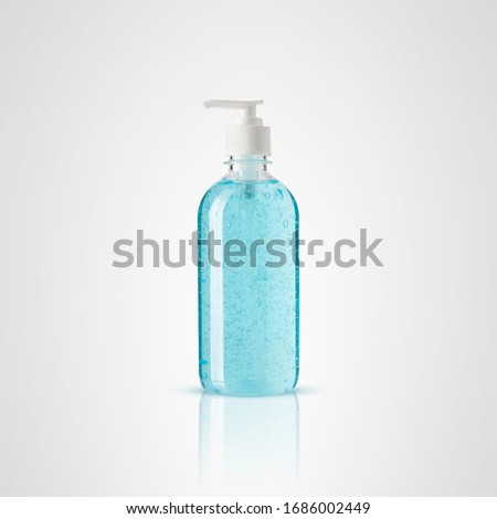 Alcohol, blue gel and bubbles in a clear plastic bottle isolated with clipping path on gray background, concept a health care and protect bacteria by disinfectant .