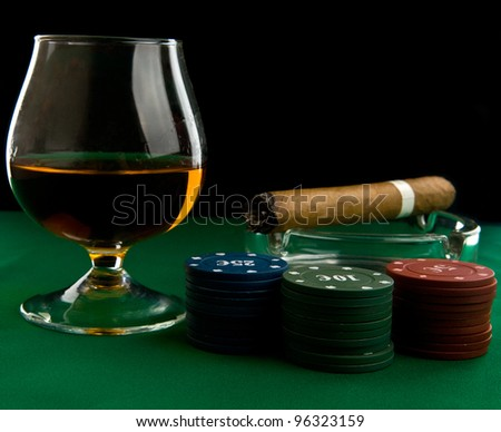 alcohol, chips and cigar on a black background