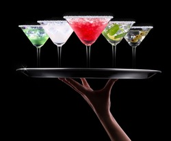alcohol cocktail set on a waiter tray