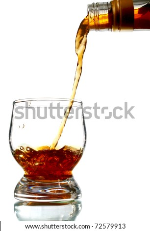 alcohol drink pouring into glass isolated on white background