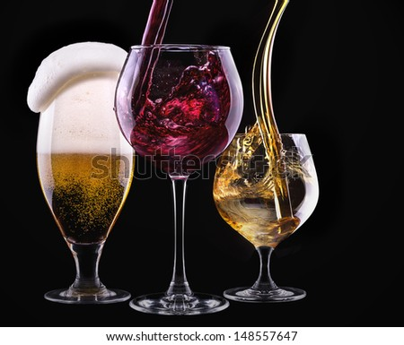 alcohol drinks set isolated on a black background - beer,wine,scotch #148557647
