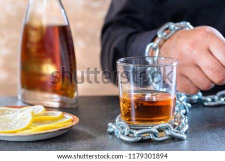 Alcohol slave or Alcoholism ,social problem. Concept alcoholism dependence. #1179301894