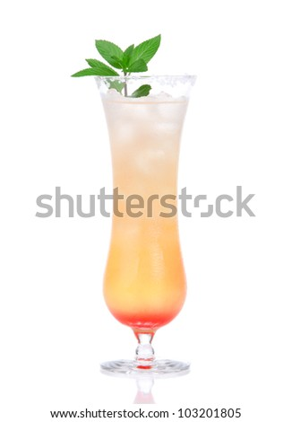 Alcohol tequila sunrise or margarita cocktail with crushed ice, green mint, yellow, lime in highball glass isolated on white background