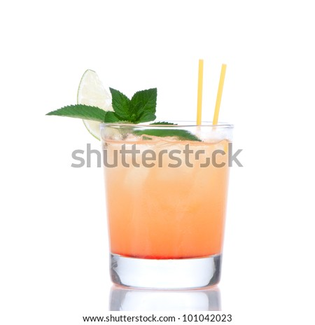 Alcohol tequila sunrise or margarita cocktail with crushed ice, green mint, yellow straws, lime in small glass isolated on white background