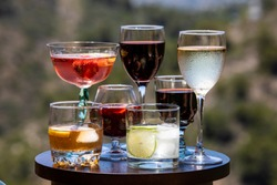 Alcoholic beverages. Different types of alcoholic beverages poured into different types of glasses.
