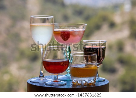 Alcoholic beverages. Summer bright drinks. Variety of alcohol in different glasses #1437631625