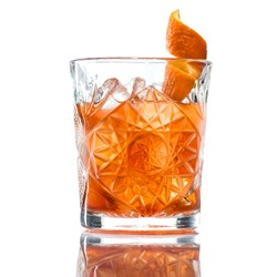 Alcoholic cocktail of the Godfather with orange peel and ice, isolated on white background