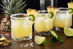 Alcoholic cocktail Pineapple Margarita, tequila with lime and jalapeno