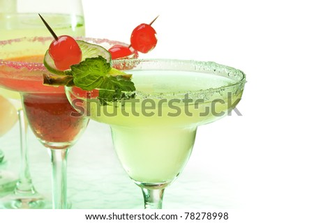 Alcoholic cocktails  Margarita decorated with cherry and lime on white background