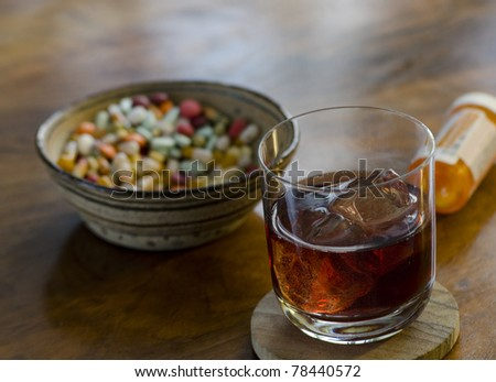 alcoholic drink and pills served as hors d'oeuvres