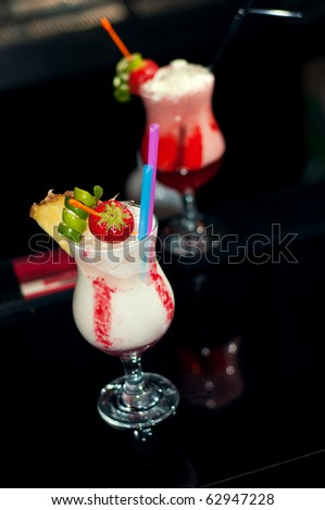 Alcoholic drinks with milk and fruits, served in restaurant and cafe