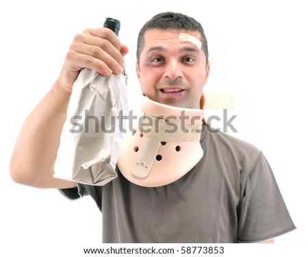 Alcoholic man with black eye wearing neck brace isolated on white.