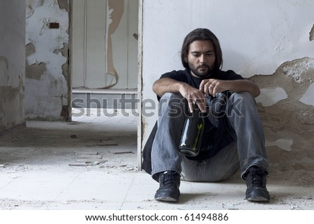 Alcoholic Sitting on the Floor