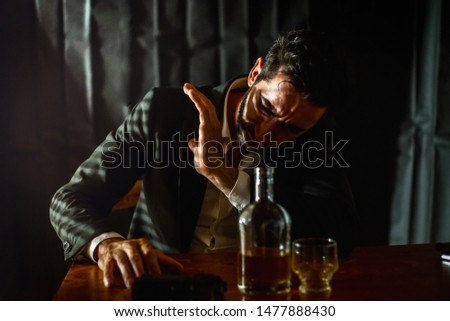 Alcoholism, alcohol addiction and concept of people - alcoholic male with glass of whiskey wakes up on the table at night #1477888430