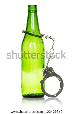 Alcoholism and drunk driving concept. Bottle and handcuffs over a white background