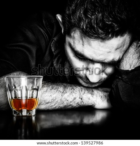 Alcoholism : Dark portrait of a lonely and desperate drunk hispanic man