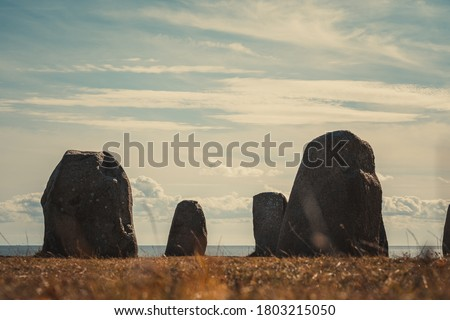 Ale Stones (Ales stenar) Is a megalithic monument of 59 large boulders and is 67 meters long. This landmark is located in Kåseberga, Sweden. Selective focus.