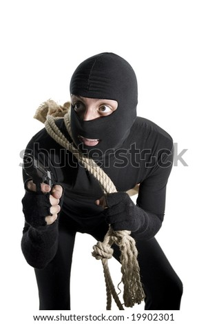 Alert thief ready to do his job isolated on white