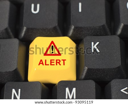 Alert word on yellow and black keyboard button