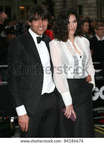 Alex James and wife arriving for the 2011 GQ Awards, Royal Opera House, London. 06/09/2011  Picture by: Alexandra Glen / Featureflash